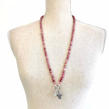 Load image into Gallery viewer, This mala necklace was created with beautiful 6mm Rhodonite beads with a Sterling Silver bead at the midpoint. It comes with a Crystal Quartz charm like the one pictured (other charms are for show only and can be purchased separately).