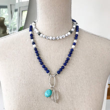 Load image into Gallery viewer, This special Intention Mala necklace was created with beautiful 8mm Lapis lazuli, Hematite and Howlite gemstones. This mala comes with a Crystal Quartz Charm like the one in the photos (the other charms are for show only and can be purchase separately).