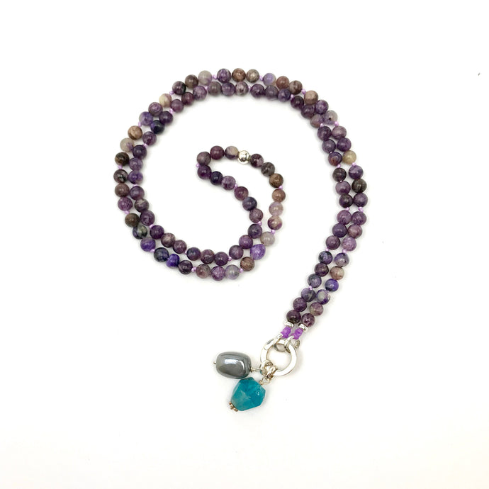 This special Intention Mala necklace was created with beautiful 6mm Charoite gemstones. This mala comes with a Crystal Quartz Charm like the one
