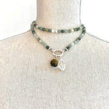 Load image into Gallery viewer, This special Intention Mala necklace was created with beautiful 6mm Green Moss Agate gemstones. This mala comes with a Crystal Quartz Charm like the one in the photos (the other charms are for show only and can be purchase separately).