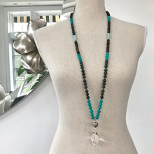 Load image into Gallery viewer, This is a peaceful and soothing Mala Necklace that reminds me of stunning beaches and pristine oceans. The stones work together to open the throat chakra, which boosts clear communication and self-expression by drawing negativity from the body. This mala Bead Necklace is made with chrysocolla, turquoise, smoky quartz and matte amazonite 8mm beads and the guru is a sterling silver Bali bead and a large smooth Crystal Quartz as a touch stone and to amplify all the energies.
