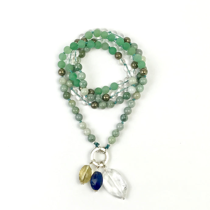 This mala necklace was created with beautiful 8mm Green Jade in various tones, Green Aventurine, Pyrite, and Crystal Quartz beads. It comes with a Crystal Quartz charm like the one pictured (other charms are for show only and can be purchased separately).