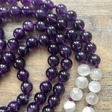 Load image into Gallery viewer, This Mala necklace is made with amethyst stones, white moonstone and a large, round lavender amethyst.  The amethysts in this mala are a beautiful, rich and dark color. They are amazing stones and are extremely beneficial to the mind, calming or stimulating as appropriate.