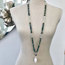 Load image into Gallery viewer, This is a very special Mala Necklace made with green Moss Agate, Moonstone, Pyrite and a large Cracked Crystal Quartz for New Beginnings.