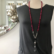 Load image into Gallery viewer, This Mala necklace is made with fuchsia agate, grey moonstone, onyx, a sterling silver Bali bead and a crystal quartz point. This mala/boho necklace will help you build self confidence. It will help you overcome negativity and bitterness of the heart, fostering love and the courage to start again.  This mala was made with lots of lov