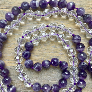 "This Mala necklace is made of amethyst and crystal quartz. This Mala is lovingly knotted every three beads with natural silk. It measures 17"" long without the guru bead. The stones are 6mm."