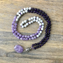 "Load image into Gallery viewer, This beautiful gemstone mala/necklace is made with 3 different types of stones for protection, tranquility, to help you deal with stress and to support you on your spiritual journey.   It's a perfect combination to help center you if you're stressed and overworked with amethyst being ""nature's tranquilizer."" Howlite is a great calming stone to help reduce anxiety and stress. Crystal Quartz is a powerful healing and energy amplifier to help activate all these energies."