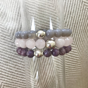 This listing is for a Mala Stack and it includes 3 beautiful bracelets: Grey agate beads 8mm, Lepidolite beads 8mm, and Faceted Rose Quartz beads 10mm. These are .925 Sterling Silver beads with the best quality stretch cord