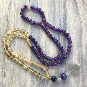 This Mala necklace features amethyst and citrine plus the guru bead which is made with a round onyx bead, a large and smooth amethyst stone and a beautiful rutilated quartz stone all hand wired with .925 Sterling Silver.  This Japa Mala can help you with an emotional or spiritual aspect that you want to work on either through meditation or your everyday life. You can also wear it or carry it with you to help you in your spiritual journey and as a reminder to live in the moment.