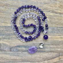 "Load image into Gallery viewer, This Mala necklace is made of amethyst and crystal quartz. This Mala is lovingly knotted every three beads with natural silk. It measures 17"" long without the guru bead. The stones are 6mm."