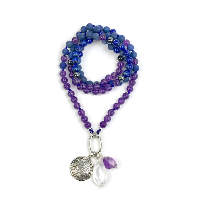 This mala necklace was created with beautiful 8mm matte and polished Lapis Lazuli, faceted Amethyst, and Hematite beads. It comes with a Crystal Quartz charm like the one pictured (other charms are for show only and can be purchased separately).