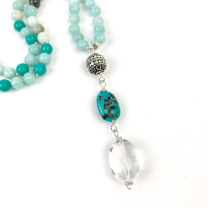 This beautiful Boho mala/necklace is made with 3 different types of gemstones for confidence, tranquility, to help you deal with stress and to support you on your spiritual journey. It features 8mm amazonite, black gold amazonite, turquoise and howlite beads placed together to create a beautiful and timeless piece.
