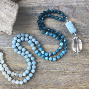This Mala necklace features Aquamarine, blue apatite and moonstone beads, plus the guru bead which is made of a beautiful, large aquamarine and a large Crystal Quartz bead.
