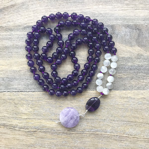 This Mala necklace is made with amethyst stones, white moonstone and a large, round lavender amethyst.  The amethysts in this mala are a beautiful, rich and dark color. They are amazing stones and are extremely beneficial to the mind, calming or stimulating as appropriate.