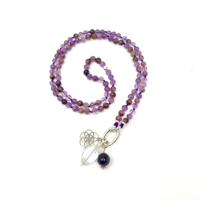 This special Intention Mala necklace was created with beautiful 6mm Purple Phantom Quartz gemstones. This mala comes with a Crystal Quartz Charm like the one in the photos (the other charms are for show only and can be purchase separately).