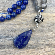 Load image into Gallery viewer, Lapis lazuli is a powerful crystal for activating the higher mind and enhancing intellectual ability. It stimulates the desire for knowledge, truth and understanding. It's excellent for enhancing memory and aids in the process of learning. It is the stone of truth encouraging honesty and harmony in relationships.