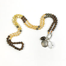 Load image into Gallery viewer, This mala necklace was created with beautiful 8mm Citrine, faceted Smoky Quartz, Yellow Opal, and Pyrite beads. It comes with a Crystal Quartz charm like the one pictured (other charms are for show only and can be purchased separately).