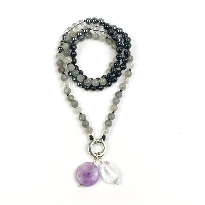 This mala necklace was created with beautiful 8mm faceted Onyx, Clear and Grey Quartz beads, and smooth Hematite beads. It comes with a Crystal Quartz charm like the one pictured (other charms are for show only and can be purchased separately).