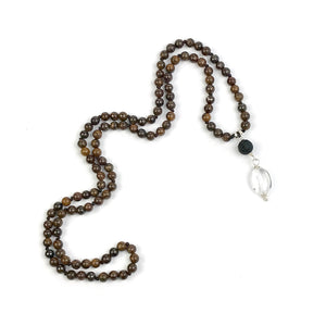 This Mala necklace features 6mm bronzite beads plus the guru bead which is made with a round lava bead followed by an oval crystal quartz bead, all hand wired with .925 Sterling Silver.