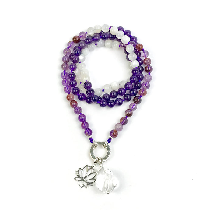 This mala necklace was created with beautiful 8mm Phantom Quartz, Amethyst, and Moonstone beads. It comes with a Crystal Quartz charm like the one pictured (other charms are for show only and can be purchased separately).
