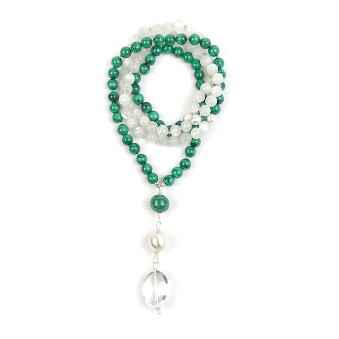 This is a very special Mala necklace made with 8 mm green malachite and moonstone beads that go beautifully together to create a timeless japa mala or boho necklace. The Guru is made with a large malachite bead, a large brushed sterling silver bead and a smooth large Crystal Quartz which makes a beautiful touch stone and is perfect to amplify the energy of the stones. There's 3 marker sterling silver brushed beads at 27, 54 and 81.
