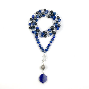 This Mala necklace features Lapis Lazuli, Ebony and Crystal Quartz beads, plus the guru bead which is made of a large Quartz bead, a Sterling Silver Bali bead and a large, oval and smooth stunning Lapis Lazuli bead. The stones are 8 mm.