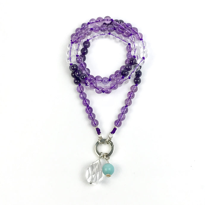 This mala necklace was created with beautiful 8mm faceted Amethyst and Crystal Quartz beads. It comes with a Crystal Quartz charm like the one pictured (other charms are for show only and can be purchased separately).