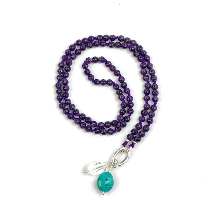 This mala necklace was created with beautiful 6mm faceted Amethyst beads. These beads have a beautiful deep purple color and an incredible sparkle. The mala comes with a Crystal Quartz charm like the one pictured (other charms are for show only and can be purchased separately).
