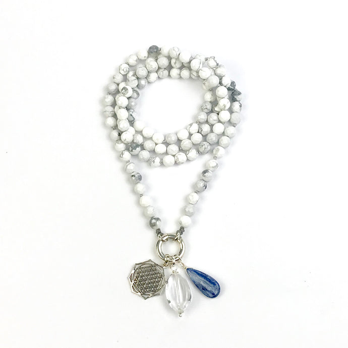 This mala necklace was created with beautiful 8mm faceted Howlite beads. It comes with a Crystal Quartz Charm like the one pictured (other charms are for show only and can be purchase separately).