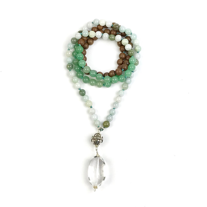 This beautiful Mala necklace is made with 8 mm multi-tone green jade, green aventurine and grey wood. The Guru bead is made with a large sterling silver Bali Bead and a smooth large Crystal Quartz which makes a beautiful touch stone.