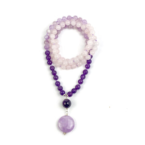 This Boho necklace features amethyst, lavender amethyst and rose quartz that together, create a beautiful ombre effect. The guru bead is made with a beautiful round amethyst bead and a large lavender amethyst bead.