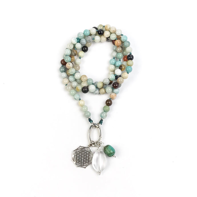 This mala necklace was created with beautiful 8mm Amazonite beads. It comes with a Crystal Quartz charm like the one pictured (other charms are for show only and can be purchased separately).