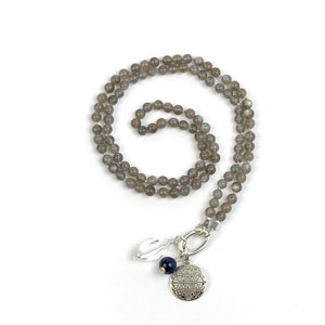 This mala necklace was created with beautiful 6mm Grey Moonstone beads. It comes with a Crystal Quartz charm like the one pictured (other charms are for show only and can be purchased separately).