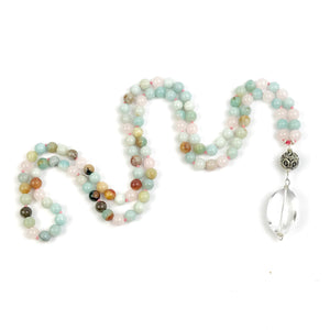 This Mala necklace features amazonite and rose quartz gemstones and the Guru is made with a large sterling silver Bali bead followed by a large smooth crystal quartz bead all hand wired with .925 Sterling Silver.