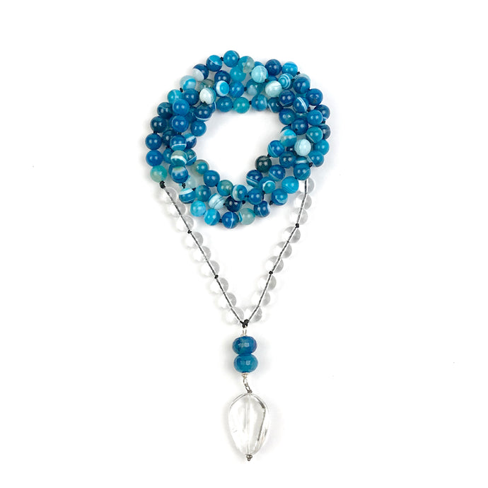 This Mala necklace is made of blue lace agate and crystal quartz. This Mala is lovingly knotted every three beads with natural silk. It measures aprox. 18
