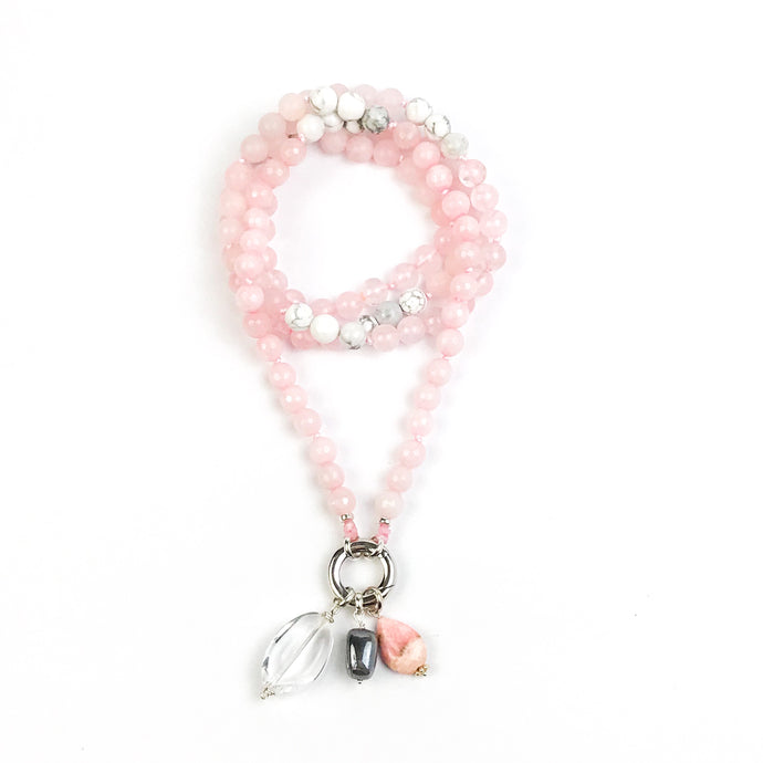This mala necklace was created with beautiful 8mm Rose Quartz and Howlite beads. It comes with a Crystal Quartz charm like the one pictured (other charms are for show only and can be purchased separately).
