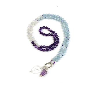 This mala necklace was created with beautiful 6mm Aquamarine, Moonstone, and Amethyst beads. It comes with a Crystal Quartz charm like the one pictured (other charms are for show only and can be purchased separately).