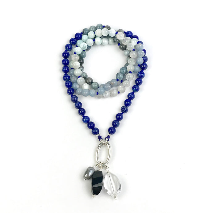 This mala necklace was created with beautiful 8mm Lapis Lazuli, Aquamarine, Moonstone, Larimar, and Angelite beads. It comes with a Crystal Quartz charm like the one pictured (other charms are for show only and can be purchased separately).