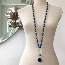 Load image into Gallery viewer, This Mala necklace features Lapis Lazuli, Ebony and Crystal Quartz beads, plus the guru bead which is made of a large Quartz bead, a Sterling Silver Bali bead and a large, oval and smooth stunning Lapis Lazuli bead. The stones are 8 mm.