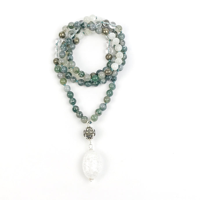 This is a very special Mala Necklace made with green Moss Agate, Moonstone, Pyrite and a large Cracked Crystal Quartz for New Beginnings.