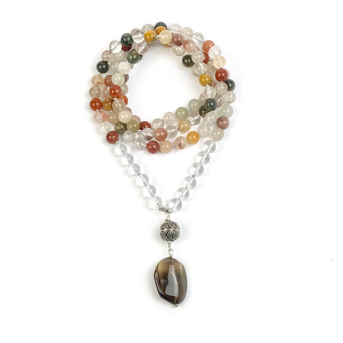 This Mala necklace features beautiful Rutilated Quartz beads that have really nice earthy tones and inclusions typical of rutilated quartz. The guru is made with a Sterling Silver Bali bead and a large, Smooth Smoky Quartz bead.