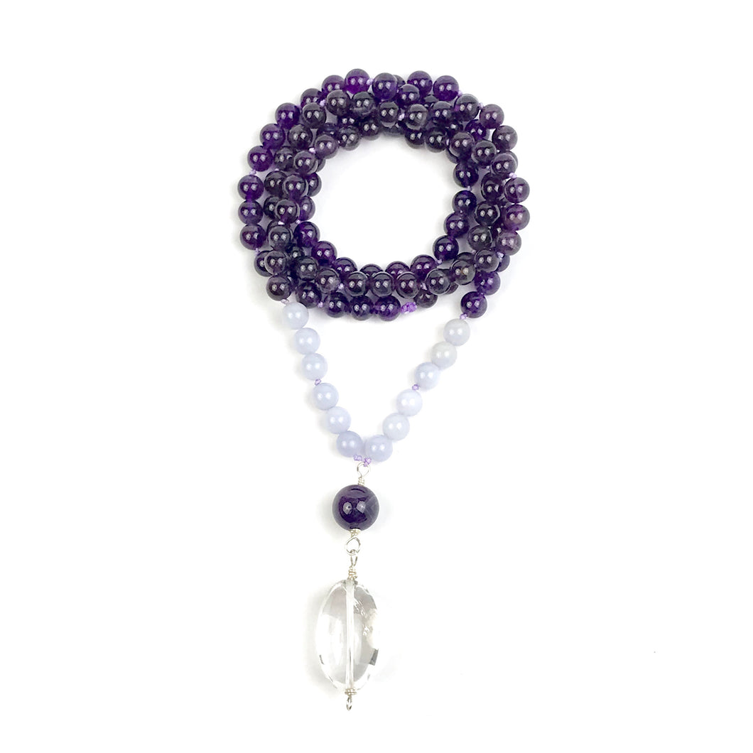 This Mala necklace is made of amethyst, crystal quartz and chalcedony. This Mala is lovingly knotted every three beads with natural silk. It measures 18.5