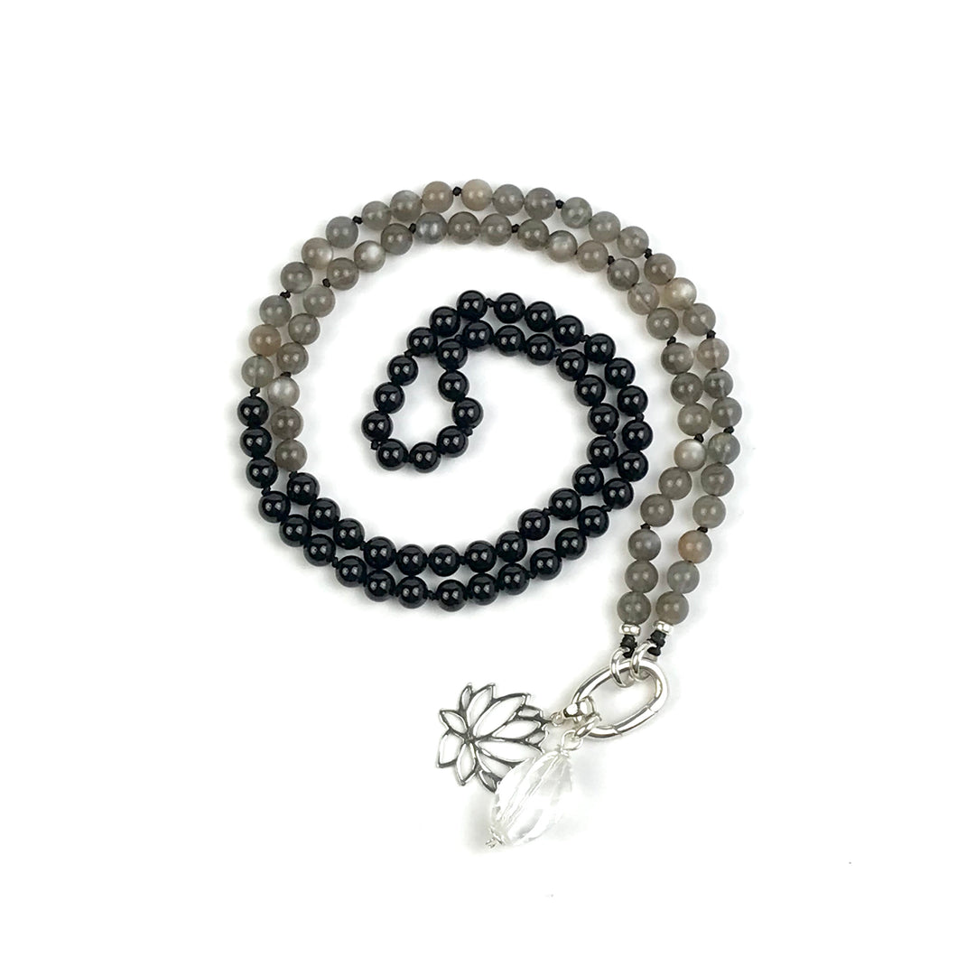 This mala necklace was created with beautiful 6mm Onyx and Moonstone beads, perfect for those who prefer a more delicate mala. It comes with a Crystal Quartz charm like the one pictured (other charms are for show only and can be purchased separately).