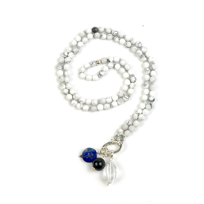 This mala necklace was created with beautiful 6mm faceted Howlite beads. It comes with a Crystal Quartz Charm like the one pictured (other charms are for show only and can be purchase separately).