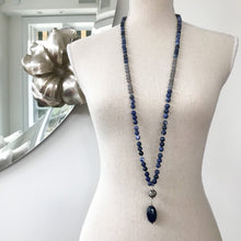 Load image into Gallery viewer, This Mala necklace features Sodalite and Grey Agate beads, plus the guru bead which is made with a sterling silver Bali bead and a large, oval blue agate stone all hand wired with .925 Sterling Silver.