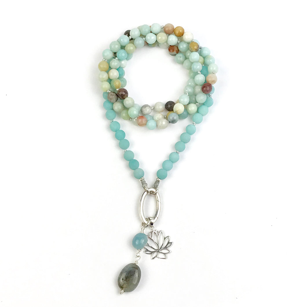 This mala necklace was created with beautiful 8mm matte, faceted Amazonite beads. It comes with a Crystal Quartz charm like the one pictured (other charms are for show only and can be purchased separately).