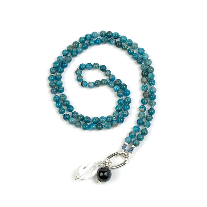 This mala necklace was created with beautiful 6mm Apatite beads. It comes with a Crystal Quartz charm like the one pictured (other charms are for show only and can be purchased separately).