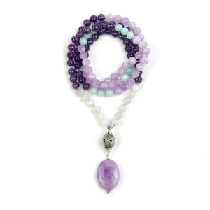 "This beautiful mala/necklace is made with 4 different types of stones for love, tranquility, courage and to support you on your spiritual journey. It's a perfect combination to help center you if you're stressed and overworked with amethyst being ""nature's tranquilizer."" The amazonite being the stone of courage will help to improve confidence and alleviate stress. Moonstone is perfect to help you with emotional balance."
