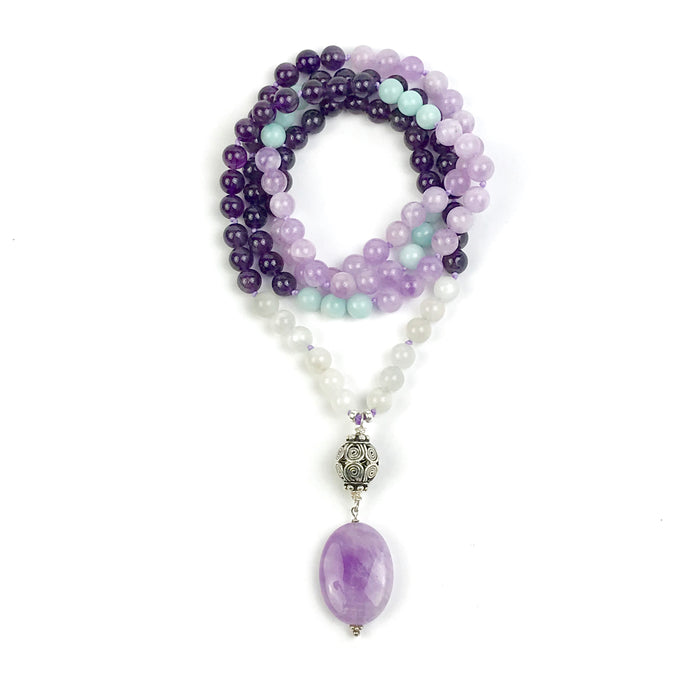 This beautiful mala/necklace is made with 4 different types of stones for love, tranquility, courage and to support you on your spiritual journey. It's a perfect combination to help center you if you're stressed and overworked with amethyst being