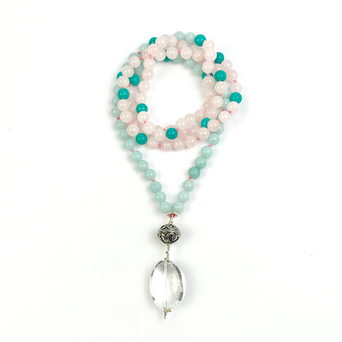 This Mala necklace features amazonite, rose quartz and turquoise gemstones and the Guru is made with a large sterling silver Bali bead followed by a large smooth crystal quartz bead all hand wired with .925 Sterling Silver.